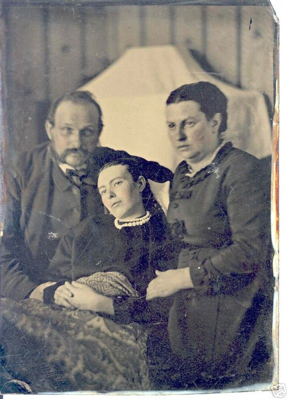 Dead young girl with her parents.